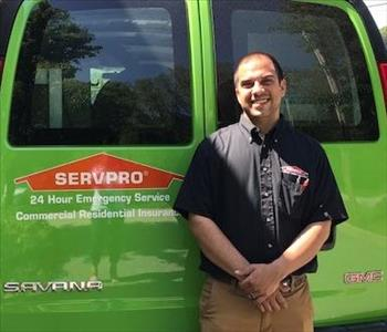 Jason - in front of one of our SERVPRO vans